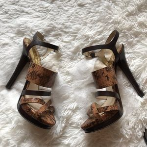 MK animal print leather sandals.